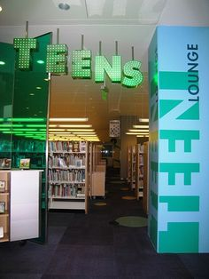 teen library spaces - Graphic and cool. Would like better lights Teen Programs, Library Programs, Library Inspiration, Library Ideas, Teen Library Space, Children's Library, School Library Decor, Library Signage, Entrance Signage