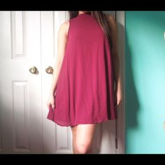 Burgundy mock neck shift dress Awesome color and super comfy material. You'll never want to get out of this dress!!! New and in great condition.  It's a medium but could fit a small depending how flowy you prefer. PRICE FIRM •No Trades• LA Hearts Dresses Mini