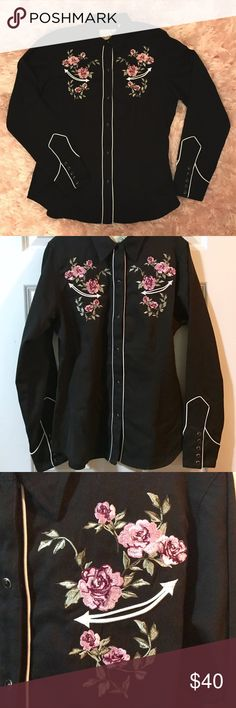 Roper Embroidered Western Shirt with Rose Detail NWOT!  Roper Embroidered Western Show Shirt, Roses 🌹 This never-worn fitted Roper women's western shirt is black with white piping, and gorgeous rose detail on the front and back, it has a black pearl snap front and 5 on each sleeve. Purchased in Denver.   Please see photos for exact measurements! Roper Tops Button Down Shirts