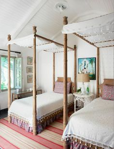 girl's island inspired bedroom with twin teak four-poster pineapple beds. | Tom Scheerer