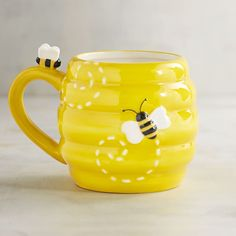 What& the buzz? Get your day started with our hand-painted, dolomite mug with three-dimensional bees.