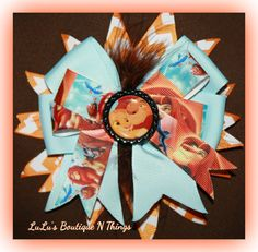 The lion king bow inspired by LuLusBoutiqueNthings on Etsy, $9.00