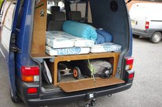 storage units in a campervan, wood, rounded corners
