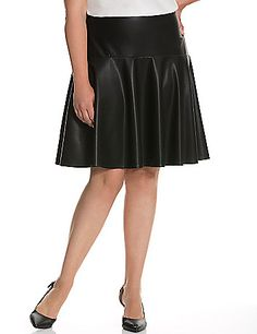 def4ce41cc9 Feminine skater skirt amps up your edge in sleek faux leather. Fully lined.  Hidden