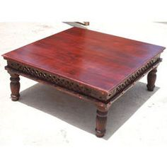 Declare your own sense of taste and style with the traditional Philadelphia Square Cherry Coffee Table. This classic cocktail table is made of solid Indian Rosewood and features and brilliant cherry stain. The living room table features hand carved wooden grill design along the edge decorated with brass inlaid details. The large coffee table also has short country column legs with additional hand carved details. This is priced at $803.99.