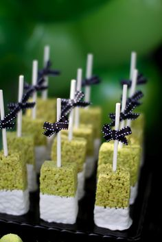 Green Rice Krispie treats dipped in white chocolate...reg. Rice Krispie dipped in pink for Gloria's baby shower?!