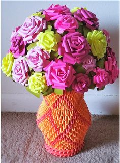 There are exactly 33 paper flowers inside this bouquet — which is no match for its vase, made up of 690 origami pieces. Claudine McNeal creates these colorful floral arrangements, which often stand out (literally) in 3D. She uses card stock when crafting these centerpieces, for durability and a longer life span. At a faraway glance, you might actually mistake this vase for a real bouquet. See her other floral origami in a variety of colors »   - HouseBeautiful.com