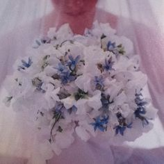 Bouquet of about 80 sweet peas interspersed with blue dots of tweedia. From The Best Of Martha Stewart Weddings 1999