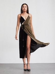 We did the matching for you. The Lana Dress is a velvet colorblock midi dress with a plunging V neckline, V back and wrap skirt. There's also an adjustable tie at the waist with fringe tassels at the end. Fits through the bodice then the skirt loosens up, so you've got some leg room. This one's also great for all those holiday parties you're about to have to go to. Made from surplus fabric.