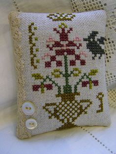 Cross Stitch primitive style pincushion