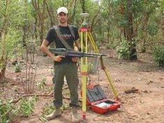 """Surveying in parts of Africa require extra protection.  Protect your """"gun"""" with an even bigger gun?"""