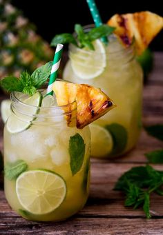 Wedding cocktail idea: Pineapple Ginger Mojitos with Spiced Rum - a sweet and spicy twist on the classic mojito cocktail. Served with a wedge of caramelized pineapple. Whether you like yours light or dark, there's a cocktail for every rum lover out there. Refreshing Summer Cocktails, Summer Drinks, Non Alcoholic Drinks, Beverages, Ginger Mojito, Ginger Cocktails, Spiced Rum Drinks, Mojito Cocktail, Drink Recipes