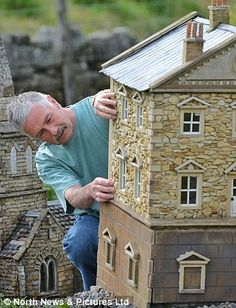Attention to detail: Lowson devotes his time now to making every inch of his miniature villages as realistic as possible