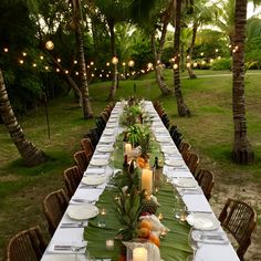 India Hicks Blog | We laid out gigantic palm fronds on top of the white tablecloths, anchored by two locally grown bunches of bananas in the center, with piles of pineapples, watermelons and oranges spilling off in each direction, and masses of tea lights dotted between shells in amongst the fruit.