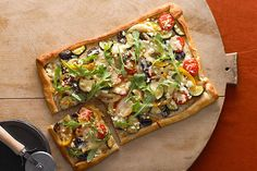 This pizza stars skillet-browned onions, peppers and zucchini topped with feta and mozzarella. And it can be on the table in about 45 minutes.