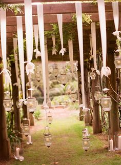 Candles...hanging from tree branches?!