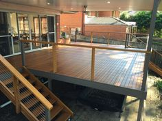 Stunning deck renovation by JGC Constructions in Quakers Hill. Nice use of screwless timber with stainless steel wire balustrade. House Deck, House With Porch, House Front, Hill House, Wire Balustrade, Balustrades, Second Story Deck, Porch Kits, Deck With Pergola