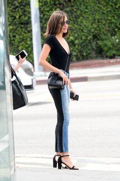 5b7636f78f3412 Who made Olivia Culpo s black fringe sweater and blue skinny jeans ...