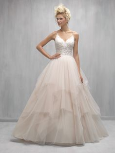 Madison James - STYLE: MJ250 - Asymmetrical layers of tulle add an edgy element to this romantic ballgown.   Colors: White/Silver, Ivory/Silver, Champagne/Ivory/Silver  Size:	2 - 32  Fabrics: Lace and Tulle