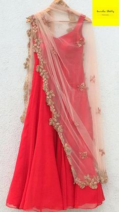 Vibrant and Stunning -Hot Red Anarkali paired with a Zardosi embroidered Dupatta.The dupatta is a statement piece by Anisha Shetty with an uneven border in Zardosi work. Zardosi is gold metallic hand embroidery from the Mughal times, and adds a. Indian Gowns Dresses, Indian Fashion Dresses, Dress Indian Style, Indian Designer Outfits, Indian Outfits, Indian Clothes, Pakistani Dresses, Girls Dresses, Designer Anarkali Dresses