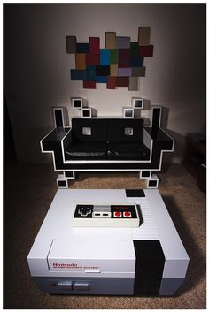 the space invader couch doesn't look comfy though. Retro gaming furniture… the space invader couch doesn't look comfy though. Gaming Furniture, System Furniture, Video Game Rooms, Video Games, Space Invaders, My New Room, Modern Chairs, Sweet Home, Geek Stuff