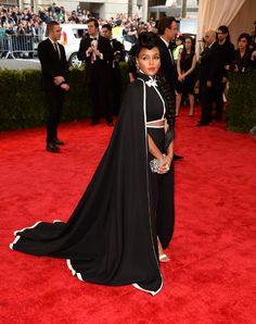 The singer, who sticks to a uniform of black and white, collaborated with H&M on this custom cape and pantsuit ensemble.