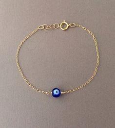 Round Blue Evil Eye Bracelet available in gold by JENNYandJUDE