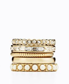 I like the combination here, but stacking rings are probably on the trendy side of things. Maybe we can consider two of these together, like the bottom two, or the baguette infinity with the cable rope ring.