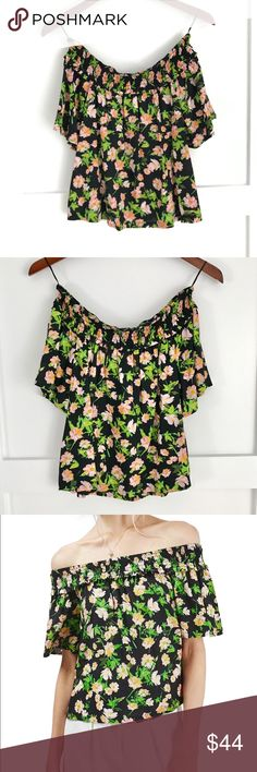 Topshop Floral Print Smocked Bardot Top Transport yourself to a blossoming apple orchard, basket in hand, with this sweet and breezy floral-print blouse topped with a ruffle-trimmed smocked neckline that can be worn on the shoulders or off whenever the mood strikes. Elastic off-the-shoulder neck. Short sleeves. 100% viscose. Machine wash warm, dry flat. By Topshop; imported. Topshop Tops