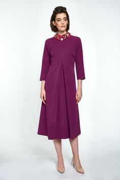 The bold hue of magenta is elegantly matched by a bold cut with a slimming effect in this dress. The collar is embellished by hand with red, coral, pink and bronze glass stones for a touch of colour, the designer signature. Coral Pink, Magenta, Collar Dress, Mid Length, Hue, Collars, Cold Shoulder Dress, Stones, Bronze