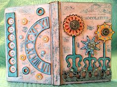 This little altered book was done for Andy Skinner's blog.  It is using primarily Tando Creative, DecoArt, Stampendous and Andy Skinner products.  You can find the complete pictorial tutorial here:  http://andyskinnerorg.blogspot.com/2017/07/gears-arent-just-for-steampunk-think.html