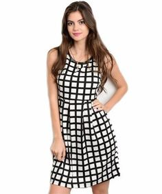 0db747eedd1b This sleeveless plaid print dress features a round neckline and an a-line  silhouette. Glamline TT
