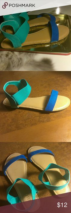 SIZE 8.5 Blue & Green SANDALS Lightly padded footbed. Slip on styling with elasticized ankle straps. Diamond embossed soles, make for great traction, which means these sandals are not the slippery type.  Blue, Green and Tan.  Brand New Without Box. Sandals were sold by manufacturer without box. Rouge Shoes Sandals