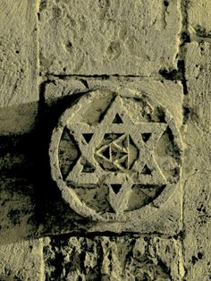 "Very old Star of David on the Inner Wall of Jerusalem: Old City. The identification of the term ""Star of David"" or ""Shield of David"" with the hexagram shape dates to the 17th century. The term ""Shield of David"" is also used in the Siddur (Jewish prayer book) as a title of the God of Israel."