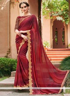 Make the heads turn after you costume up in this attractive maroon faux georgette classic designer saree. The lovely embroidered and patch border work throughout the dress is awe inspiring. Comes with...
