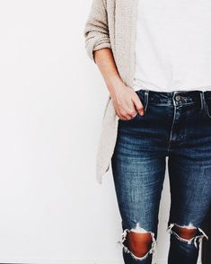 Gray cardigan over white tee and trendy distressed denim jeans.