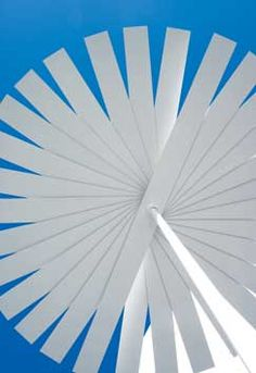 """Gandia Blasco - """"Ensombra"""" shade umbrella means """"in the shade"""" in Spanish.  This giant white pinwheel of an umbrella is fit for all kinds of weather, thanks to a pole of galvanized steel and a canopy of plastic-laminate strips. Both height and width are 84 inches. 4 Calle Músico Vert, 46870 Ontinyent (Valencia), Spain; 34-90-253-0302; gandiablasco.com."""