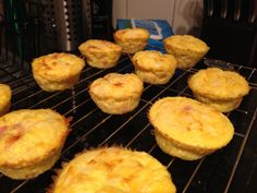 Mini quiches. Low carb breakfast.   Mix 9 eggs and .5c milk  Sautée onions with ham   Add to eggs with 1c shredded cheddar  Pour mix into silicon cupcake moldes   Bake at 350 for about 10-15 minutes until the tops are brown.