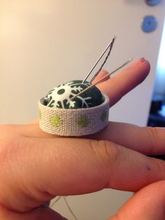 My attempt at the bottle cap pin cushion ring. It's surprisingly simple to make, it took a fair amount of time but most of that was getting the holes in the bottle cap. I used garden twist wire for the ring and some old fabric and bit of a kitchen sponge for the pin cushion. It's actually very useful, I feel lost sewing without it now!