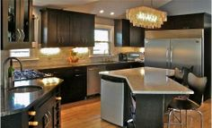 Kitchen with dark shaker style cabinets with black stain finish.