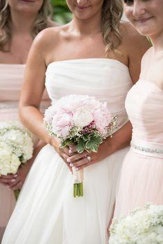 bride holding blush and white peony bridal bouquet by Flourish Productions-Paradise Cove Orlando wedding- Photo: Corner House Photography- Orlando wedding blog-Orange Blossom Bride