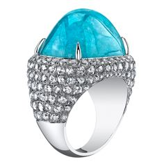 perfect pool blue! a  28.98ct cushion Paraiba Tourmaline cabochon, set in a hand crafted platinum ring, accented by 3.46ct total of rose cut diamonds and 0.72ct total of round brilliant diamonds.