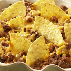 Taco Casserole Recipe - take out the tortilla chips and use lean ground turkey.  Used reduced fat cheddar and went light on the cheese to make it a lighter :)