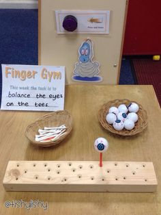 Finger Gym - golf tees and eyeballs Get your golf equipment at Golf USA… Motor Skills Activities, Fine Motor Skills, Classroom Activities, Activities For Kids, Eyfs Classroom, Eyfs Activities, Nursery Activities, Classroom Ideas, Finger Gym