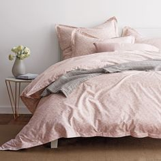 Rose duvet cover woven from luxurious 400-thread count cotton sateen and sprigged with abstract botanicals.