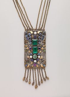 Necklace Maker: Frank Gardner Hale (1876–1945) Date: ca. 1920 Geography: New England, Boston, Massachusetts, United States Culture: American Medium: 18kt yellow gold, silver, peridots, amethysts, tourmalines, sapphires, and pearls. Dimensions: Length: 42 in. (106.7 cm) Pendant: 3 1/4 x 1 1/4 in. (8.25 x 3.2 cm) Classification: Jewelry Credit Line: Gift of Jacqueline Loewe Fowler, 2014