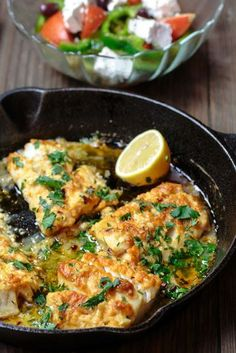 Greek-Style Baked Cod Recipe with Lemon and Garlic | The Mediterranean Dish. Easy, weeknight dinner! Baked cod, spiced Greek-style and baked with fresh lemon juice, olive oil and garlic. Takes 15 minutes or less in your oven! #greekfood #codrecipe #mediterraneanrecipe #bakedcod #bakedfish #onepandinner