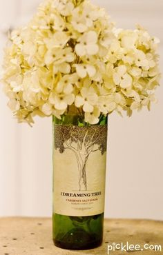 Upcycle wine bottles with your favorite labels into flower vases.