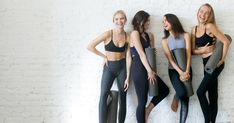 Group of young sporty girls with yoga mats standing at white wall. Group of young sporty girls with yoga mats, copyspace stock photo Sporty Girls, Muscle Fitness, Fitness Tips, Fitness Yoga, Zumba, Yoga Clothing Brands, Yoga Brands, Mode Yoga, Photo Yoga
