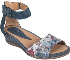 Earth Hera Sandal in Blue. A snake-embossed strap and slim wrapped wedge  lend